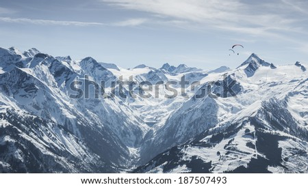Winter paragliding above Alps in Austria with Kitzsteinhorn view
