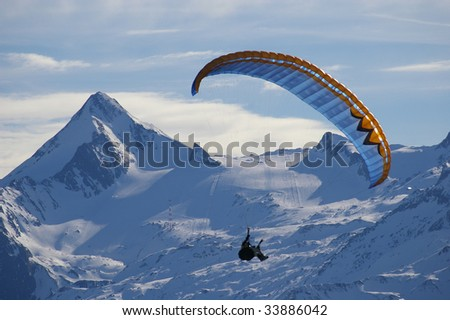 winter paragliding in alps mountains - stock photo