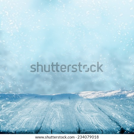 Winter path in forest and flying snow - stock photo