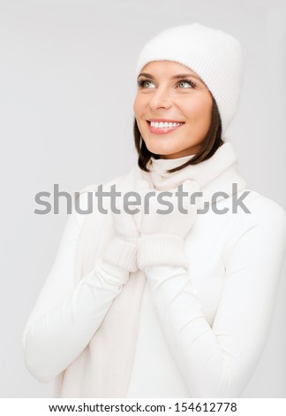 winter, people, happiness concept - woman in hat, muffler and gloves