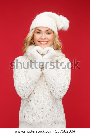 winter, people, happiness concept - woman in hat, scarf and mittens - stock photo