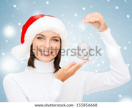 winter, people, happiness concept - woman in santa helper hat with christmas tree decoration