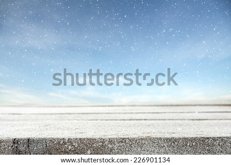 winter photo of blue sky with snow and frost decoration on table  - stock photo