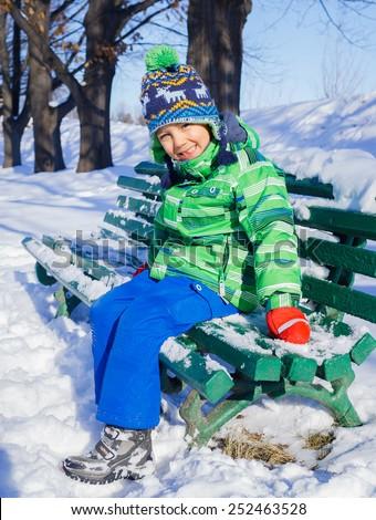 Winter, play, fun - Cute little boy having fun in winter park - stock photo