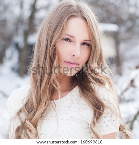 winter portrait of a beautiful blonde - stock photo