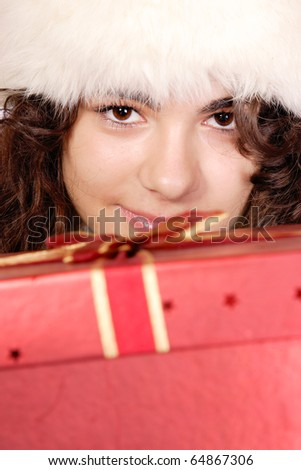 winter portrait of a beautiful young smiling teen with a gift - stock photo