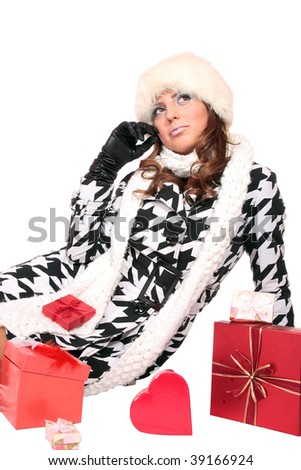 winter portrait of a beautiful young smiling woman with a gift