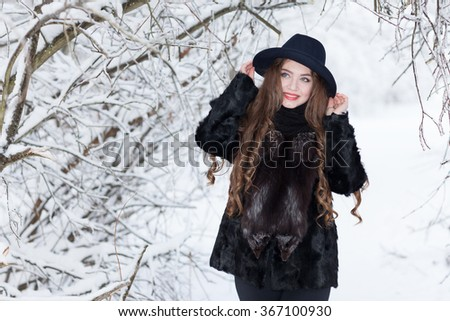 Winter portrait of a girl in a hat - stock photo