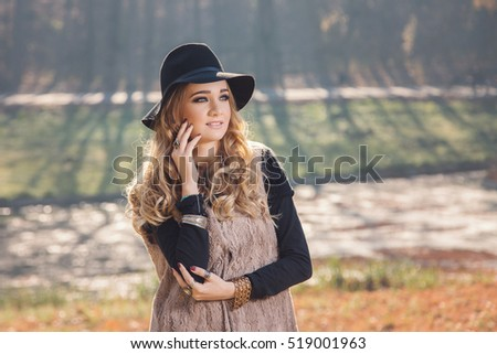 Winter portrait of a hippie young woman wearing a hat