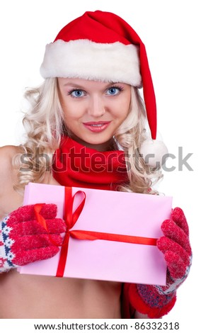 winter portrait of a smiling woman with a gift in her hands