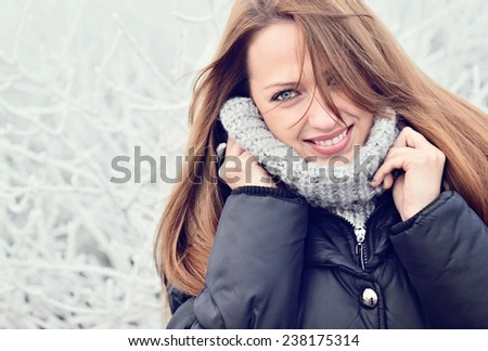 Winter portrait of beautiful girl - stock photo
