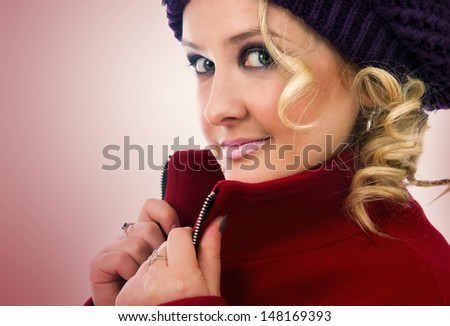 winter portrait of smiling girl with hat