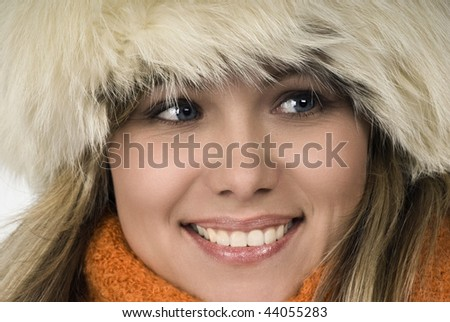 Winter portrait of the young attractive girl.