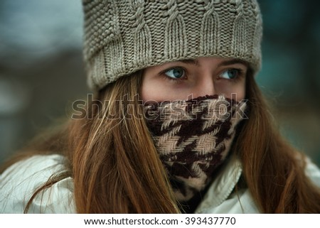 winter portrait of young woman. Model feels a cold air. - stock photo
