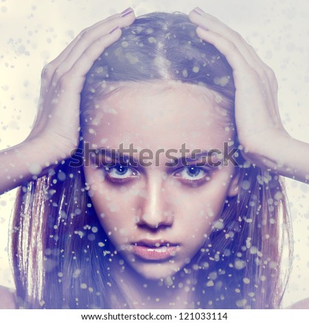 winter portrait snow flakes fashion face freeze wind blue gamma ice looking - stock photo