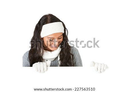 Winter: Pretty Girl Behind White Card Looking Down - stock photo