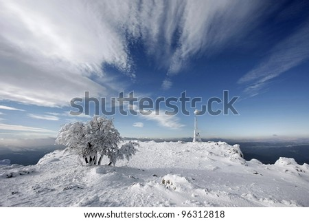 Winter pretty picture on top of mountain - stock photo