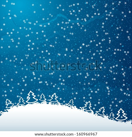 Winter real falling snow on atmospheric blue background with Christmas trees at the bottom
