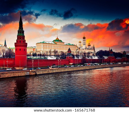 Winter red sunset in Moscow, Russia (The Grand Kremlin Palace and Kremlin wall)  - stock photo