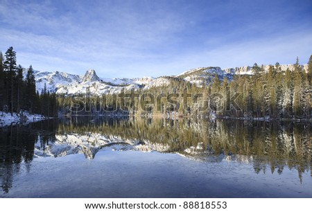 Winter reflections at Mamie Lake (Mammoth Lakes) in eastern Sierra Nevada mountains, California - stock photo