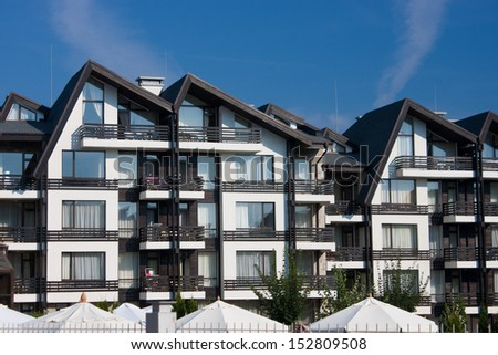 Winter resort building in the mountain. This image is shot with CPL filter and processed in 16 bit sRGB mode. Space for text available. - stock photo