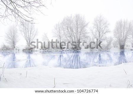 winter river and trees in winter season - stock photo