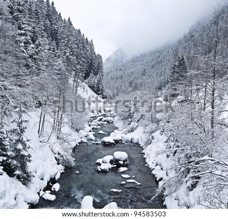 winter river in mountains - stock photo