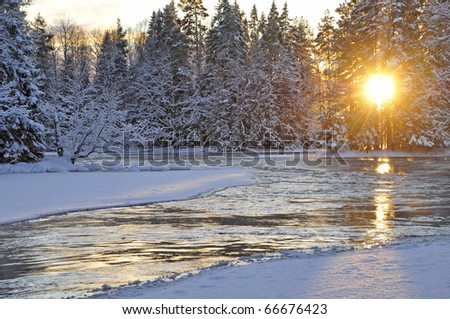 Winter river landscape and sunset - stock photo