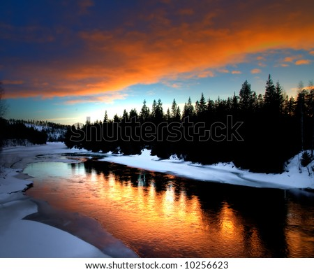 winter river scenery from Lapland in the north of sweden - stock photo