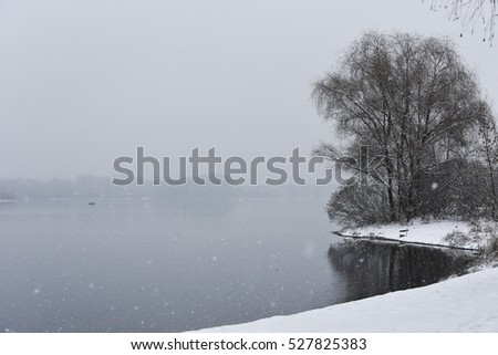 Winter river snowing