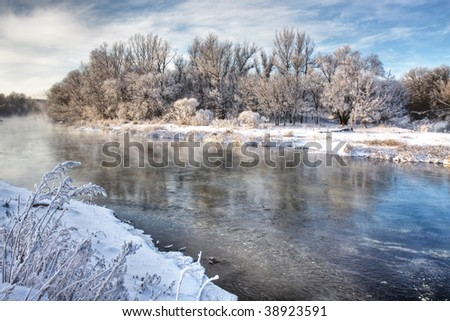 Winter river with claer reflection - stock photo