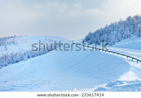Winter road after heavy snowfall - stock photo