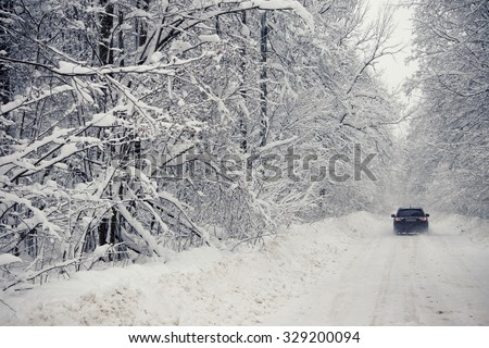 Winter road after snowfall - stock photo