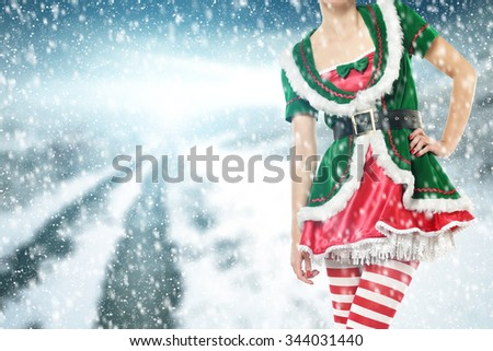 winter road background woman in green dress and red with white color of legs  - stock photo