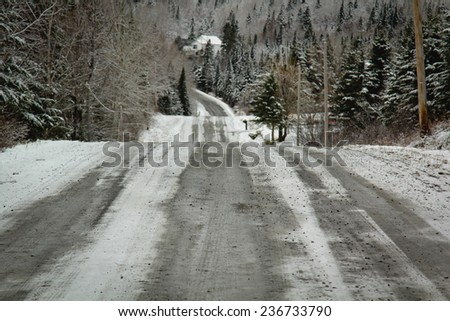 Winter road in Canada - stock photo