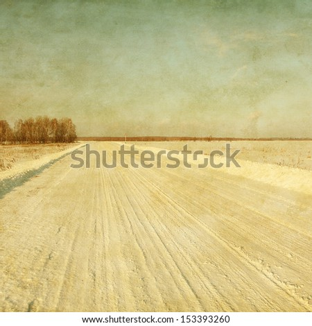 Winter road in grunge and retro style. - stock photo