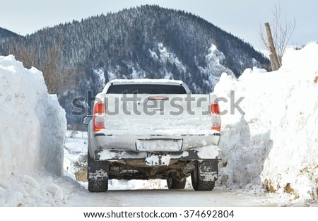 Winter road in mountains after snowfall