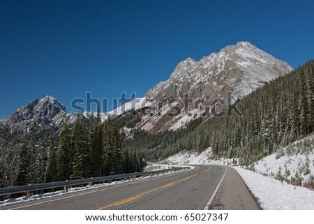 Winter Road of the Canadian Rockies in Kananaskis - stock photo