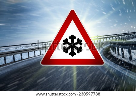 winter road sign on highway - stock photo