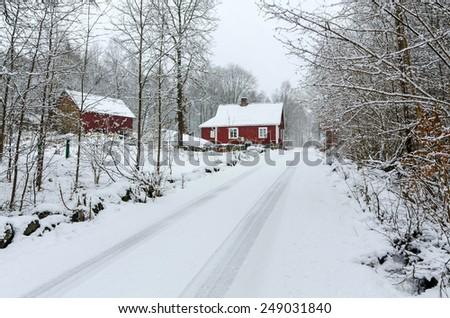 Winter road to Swedish village - stock photo