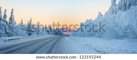 Winter road to the mountain - stock photo