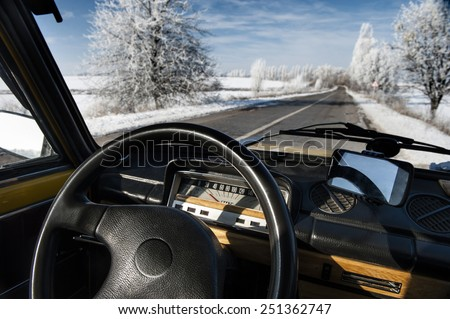 Winter road,  view from  interior of car.