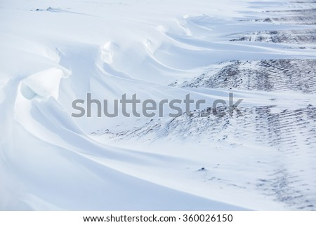 Winter road. Winter background. Drifts, snow kiddle, Copy space. - stock photo