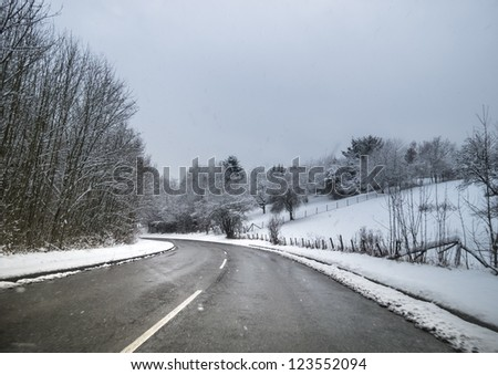 Winter road with bend - stock photo
