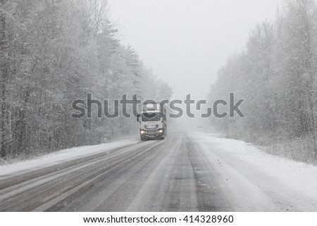 Winter road with blowing snow. - stock photo