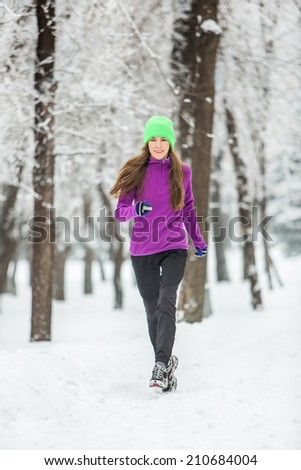 Winter running, exercise woman. Healthy lifestyle - stock photo