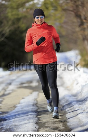 Winter running, exercise woman.  Healthy lifestyle, active woman concept. - stock photo