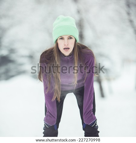 Winter running, exercise woman. toned filter image - stock photo