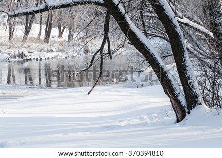 Winter rural landscape Frozen River in the forest