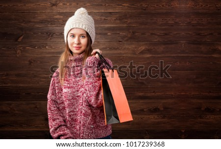 Winter sale concept. Young girl with shopping bag.
